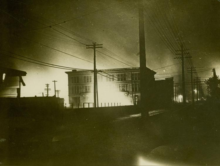 Fire burns on the night of the riot in East St. Louis near the city library, at Eighth Street and Broadway. (Missouri History Museum)