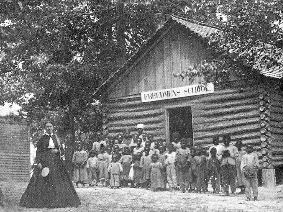 The Bureau helped support schools like this one at James' Plantation, North Carolina to educate newly freed children. (Learn NC, University of North Carolina)
